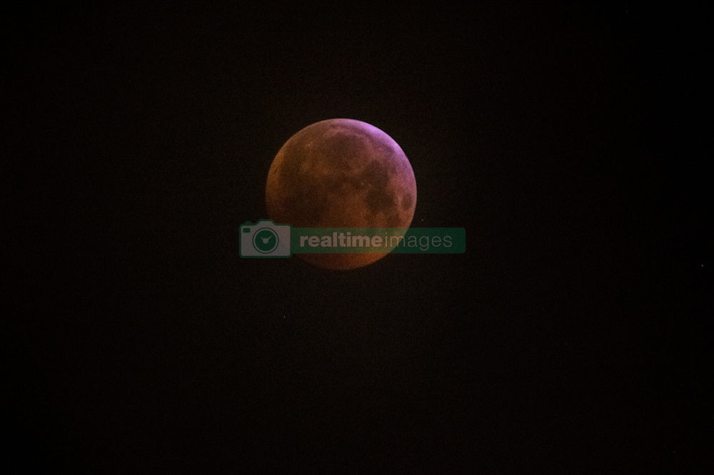 January 21, 2019 - London, United Kingdom - Super blood wolf moon at early morning hours in London. (Credit Image: © Brais G. Rouco/SOPA Images via ZUMA Wire)