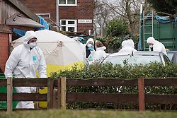 © Licensed to London News Pictures . 26/03/2015 . Manchester , UK . A forensic tent pitched in front of the entrance to a garage adjoined to the house . Forensic scenes of crime examiners search a house on Chain Road , Blackley , North Manchester as police in Manchester say they are investigating historical crimes . Approximately a dozen police and forensic examiners and eight police vehicles are deployed at the scene . Photo credit : Joel Goodman/LNP