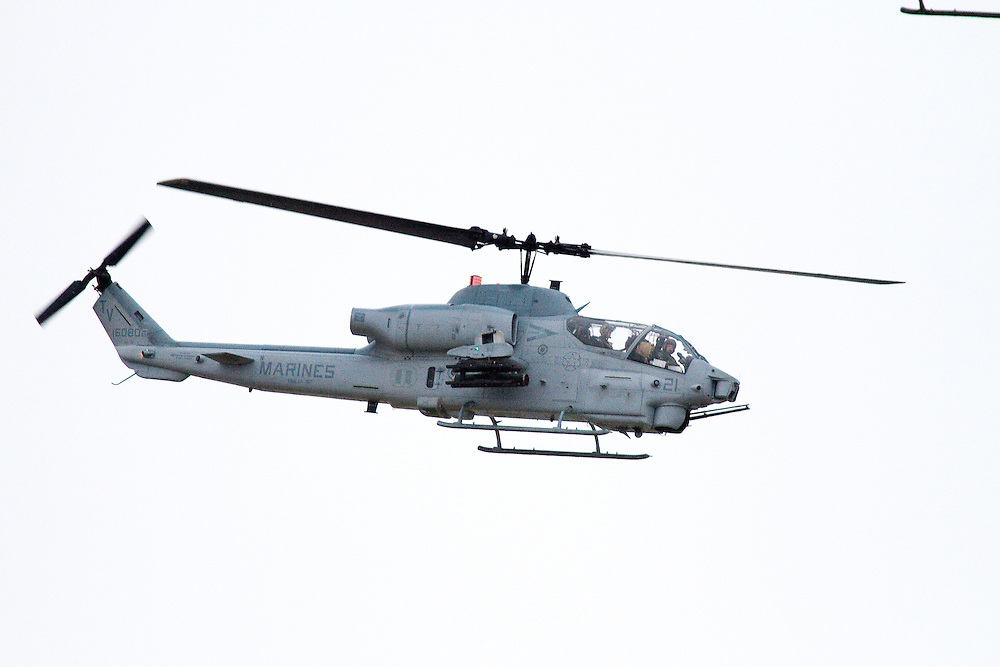 A Marine Cobra attack helicopter provided air cover and escort for the USS New York which was leaving New York Harbor after its commissioning.