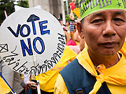 """22 JUNE 2011 - BANGKOK, THAILAND: Thai Yellow Shirts call for a no vote during a pre-election rally in Bangkok on Wednesday, June 22. The PAD (People's Alliance for Democracy) or Yellow Shirts, as they are popularly called, has called for a """"No"""" vote in Thailand's national election, scheduled for July 3. PAD leadership hopes the no vote will negate the vote of Yingluck Shinawatra, leader of the Pheua Thai party. Yingluck is the youngest sister of exiled former Prime Minister Thaksin Shinawatra, deposed by a military coup in 2006. Yingluck is currently leading in opinion polls, running well ahead of incumbent Prime Minister Abhisit Vejjajiva, head of the Democrat party, which in one form or another has ruled Thailand for most of the last 60 years.     Photo by Jack Kurtz"""