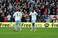 West Ham's Carlton Cole ® celebrates with teammate George McCartney after he scores his sides 1st goal.   Barclays Premier league, Cardiff city v West Ham Utd match at the Cardiff city Stadium in Cardiff, South Wales on Saturday 11th Jan 2014.<br /> pic by Andrew Orchard, Andrew Orchard sports photography.