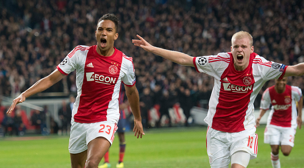 Ajax's Danny Hoesen scored the 2-0 during the Group H Champions League soccer match between Ajax and FC Barcelona at the ArenA stadium in Amsterdam, Netherlands, Tuesday Nov. 26, 2013. (AP Photo/Patrick Post) At the right Davy Klaassen.