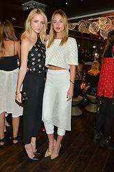 Left to right, ALEK ALEXEYEVA and ERIN FEE at the Launch Of Osman Yousefzada's 'The Collective' 4th edition with special guest collaborator Poppy Delevingne held in the Rumpus Room at The Mondrian Hotel, 19 Upper Ground, London SE1 on 24th November 2014, sponsored by Storm models and Beluga vodka.