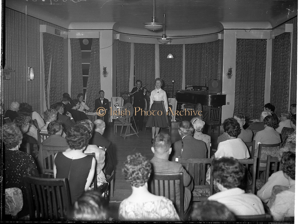 27/06/1959<br /> 06/27/1959<br /> 27 June 1959<br /> Gael Linn Cabaret at Bundoran. Picture shows Gertie Mc Cormack, All-Ireland Champion Dancer yearly since 1953, performing a hornpipe to fiddler Sean Maguire's accompaniment, during the cabaret.
