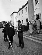 Having had a few lessons from All-Ireland winner Jack Lynch, King Baudouin of Belgium takes a puck at the sliotar in the grounds of the Áras an Uachtarain.<br /> 17.05.1968