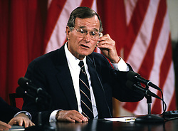 United States President George H.W. Bush adjusts his earpiece as he makes remarks during a joint press conference with President Mikhail Gorbachev of the Union of Soviet Socialist Republics, at the conclusion of their summit in the East Room of the White House in Washington, DC on Sunday, June 3, 1990. Photo by Ron Sachs / CNP /ABACAPRESS.COM
