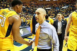 Jan 20, 2018; Morgantown, WV, USA; Texas Longhorns head coach Shaka Smart shakes hands with West Virginia Mountaineers players after the game at WVU Coliseum. Mandatory Credit: Ben Queen-USA TODAY Sports