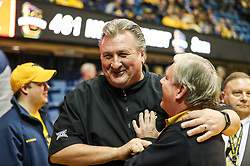 Jan 6, 2018; Morgantown, WV, USA; West Virginia Mountaineers head coach Bob Huggins jokes with a fan before their game against the Oklahoma Sooners at WVU Coliseum. Mandatory Credit: Ben Queen-USA TODAY Sports