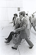 After being shot in Georgia, Hustler Magazine publisher Larry Flynt - in wheelchair - stands trial in 1979 on obscenity charges in Atlanta. Security expert Gavin DeBecker - in suit and sunglasses at Flynt's side - leads a protective detail as Flynt arrives and departs court. de Becker - now in 2019 - security chief for Amazon's Jeff Bezos, leads a team of investigators probing the American Media - National Enquirer case alleging extortion of Bezos - the world's richest man.
