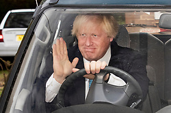 © Licensed to London News Pictures. 11/09/2018. Thame, UK. Boris Johnson waves to reporters as he leaves his Oxfordshire house. Last week it was announced that Boris Johnson and his wife Marina Wheeler are getting divorced. Photo credit: Peter Macdiarmid/LNP