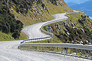 Gravel road winds along a steep mountainside in The Remarkables, near Queenstown.
