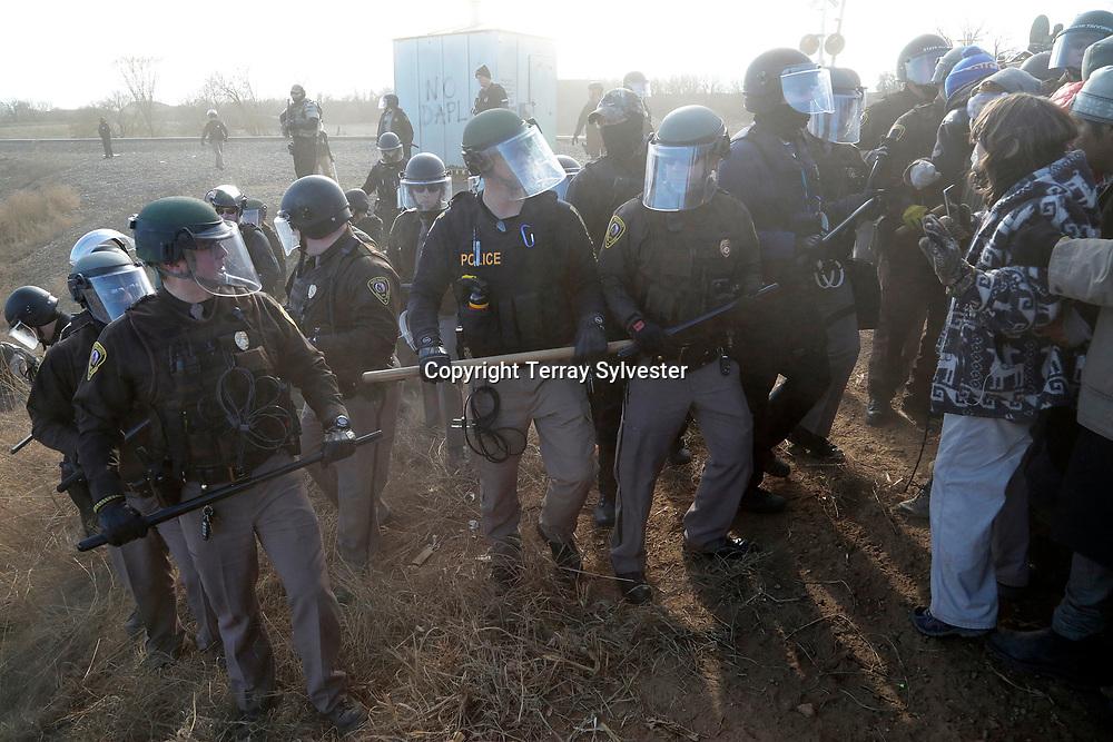 Police confront opponents of the Dakota Access oil pipeline on November 15, 2016. Mandan, North Dakota, United States.