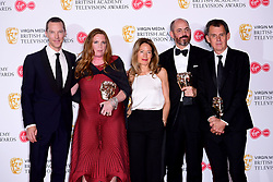 Benedict Cumberbatch (left) with the Cast and Crew of Patrick Melrose after winning the award for Best Mini-Series in the press room at the Virgin Media BAFTA TV awards, held at the Royal Festival Hall in London.