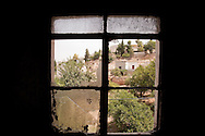 The view from a window in a house raided and burnt by the Syrian army when they arrived in the town of Lejj, Idlib province, Syria. The area has been extensively shelled and raided by the Syrian Army and pro-government Shabiha militias in recent months.