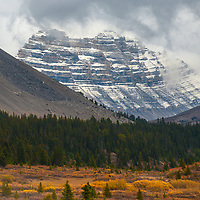 Clouds envelop a mountain in the Canadian Rockies.