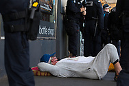 A protester, attached to another protester waits as police look for tools to remove their pipe during an Extinction Rebellion protest in Melbourne.  A small group of climate protesters marched from Flagstaff Gardens to The Queen Victoria Market and ending with two individuals gluing themselves together, and then glued themselves to Victoria Avenue outside of the Market. This comes as 5 new COVID-19 cases were uncovered in Melbourne's revamped Hotel Quarantine, breaking almost 40 days of virus free days. (Photo by Dave Hewison/Speed Media)