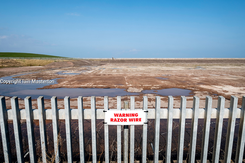 "Cockenzie, UK. 14 April, 2018. View of site of the former Cockenzie power station in East Lothian, Scotland. A row has begun over concerns about the Scottish government's decision to ""call in"" a planning application by Red Rock Power to build a renewable energy sub-station on the site. Red Rock Power, part of China's largest state-owned investment fund, the State Development and Investment Corporation (SDIC), wants the the sub-station to allow it  to feed power from the Inch Cape offshore wind farm, near Angus, into the national grid."