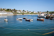 Ferry boat and dinghies in the harbour, St Mawes, Cornwall, England, UK