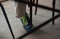 21 MAY 2012, BERLIN/GERMANY:<br /> Turnschuh von Christophe F. Maire, Gruender / CEO txtr, Inhaber atlantic ventures, Investor und  Business Angel, waehrend einem Interview, txtr GmbH, Rosenthaler Str., Berlin-Mitte<br /> IMAGE: 20120521-02-035<br /> KEYWORDS: Christophe Maire