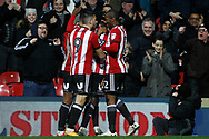 Florian Jozefzoon of Brentford celebrates with his team mates after he scores his team's second goal. EFL Skybet football league championship match, Brentford v Sheffield Wednesday at Griffin Park in London on Saturday 30th December 2017.<br /> pic by Steffan Bowen, Andrew Orchard sports photography.