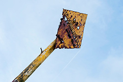 A Badly rust damaged yellow underwater telephone cable marker on the shore line of Dunoon West Bay<br />  <br /> 04 April  2015<br /> Image © Paul David Drabble <br /> www.pauldaviddrabble.co.uk