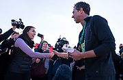 Democratic 2020 presidential candidate Beto O'Rourke, 46, speaks with supporters after running a St. Patrick's Day 5K race during a three day road trip across Iowa, in North Liberty, Iowa, U.S., March 16, 2019.  REUTERS/Ben Brewer