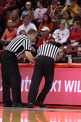 27 January 2018:  Ray Natili and Tom O'Neill check the video for a hard foul during a College mens basketball game between the Valparaiso Crusaders and Illinois State Redbirds in Redbird Arena, Normal IL