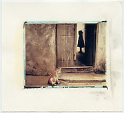 Girl standing in the doorway of her home, Lamu, Kenya<br /> Image size 4x5, Matted 12x10 Edition of 25 <br /> Archival Pigment Print