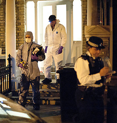 © licensed to London News Pictures. 29/06/2011. London, UK. Police forensics at the scene where dismembered human body part, believed to be a head, was found in a West London garden last night (28/06/2011). Officers search the basement of a property in West Kensington where the body part was believed to have been found. See special instructions . Photo credit should read Jules Mattsson/LNP
