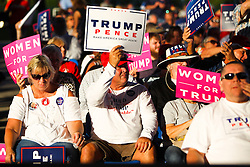 October 24, 2016 - Tampa, Florida, U.S. - WILL VRAGOVIC   |   Times.Phil Vernier, 60, of Tampa hoist a Trump-Pence sign before the Trump rally at the MidFlorida Credit Union Amphitheatre in Tampa, Fla. on Monday, Oct. 24, 2016. ''I heard it was an inspiring event,'' Vernier said, ''I've never attended one (a political rally) before. Trump needs our support. (Credit Image: © Will Vragovic/Tampa Bay Times via ZUMA Wire)