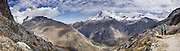 Nevado Huandoy (center, 20,866 feet or 6360 meters elevation) rises high above Llanganuco Valley and the switchbacked road to Portachuelo Pass (15,639 feet / 4767 meters) in Huascaran National Park (UNESCO World Heritage Site), Cordillera Blanca, Andes Mountains, Peru, South America. This panorama was stitched from 6 overlapping photos.