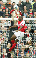 16/10/2004<br />FA Barclays Premiership - Arsenal v Aston Villa - HIghbury<br />Arsenal's Sol Campbell jumps higher than the outstretched arms of Aston Villa's goalkeeper Stefan Postma.<br />Photo:Jed Leicester/BPI (back page images)