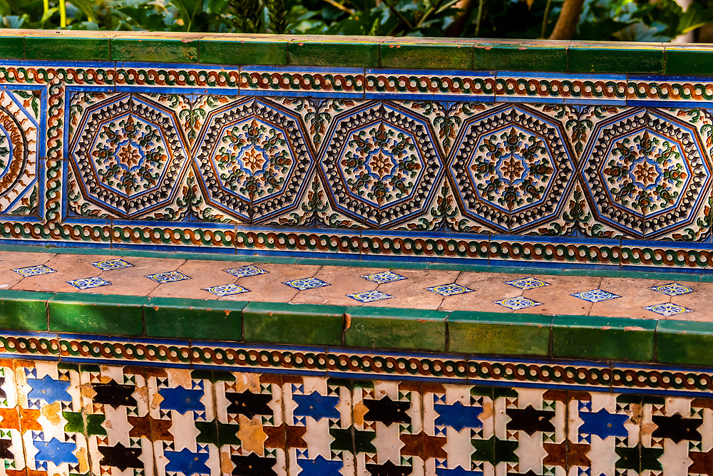 Tiled bench in the gardens, The Alcázar of Seville (Real Alcazar) is a royal palace in Seville, Spain, built for the Christian king Peter of Castile.