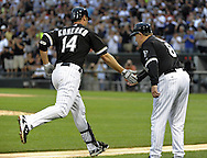 CHICAGO - JUNE 21:  Paul Konerko #14 is greeted by third base coach Jeff Cox #8 of the Chicago White Sox after hitting a solo home run in the second inning off of Matt Garza #17 of the Chicago Cubs on June 21, 2011 at U.S. Cellular Field in Chicago, Illinois.  Konerko has hit a home run in 5 straight games. The White Sox defeated the Cubs 3-2.  (Photo by Ron Vesely)  Subject:  Paul Konerko;Matt Garza;Jeff Cox