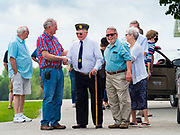 25 MAY 2020 - ROLAND, IOWA: FLOYD RITLAND (center), 93, a veteran of World War II, talks to people in Roland Cemetery, in Roland, Iowa, a farming community an hour north of Des Moines. In 2020, most public Memorial Day events in Iowa were canceled because of the COVID-19 pandemic, but some families, including the Ritlands, had their own private events. Memorial Day is a federal holiday to honori and mourn the military personnel who have died while serving in the United States Armed Forces. Memorial Day is observed on the last Monday in May.         PHOTO BY JACK KURTZ