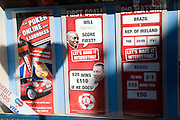 Window display for betting on sports at bookmaker's - an example of a specialist shop in the leisure industry