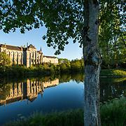 Like a fortress standing on the Sarthe river banks, the Solesmes abbey founded in the 11th century is home to a community of about fifty Benedictine monks. 04-05-16<br /> Telle une forteresse qui se dresse sur les rive de la Sarthe, l'abbaye de Solesmes fondée au XI ème siècle abrite une communauté d'une cinquantaine de moines bénédictins. 04-05-16
