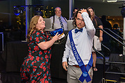 Teacher Dawn Foley, the prom sponsor, awards the Junior Prom Prince, Lance Padgett as Fairdale High School holds it's prom at the Muhammad Ali Center on Saturday, May 18.