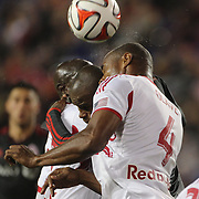 Jamison Olave , New York Red Bulls and Jackson, Toronto FC, clash heads while challenging for a ball during the New York Red Bulls Vs Toronto FC, Major League Soccer regular season match at Red Bull Arena, Harrison, New Jersey. USA. 11th October 2014. Photo Tim Clayton