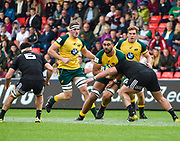 Australia second-row Lukhan Lealaiaulolo-Tui drives at the New Zealand defence during the World Rugby U20 Championship 5rd Place play-off  match Australia U20 -V- New Zealand U20 at The AJ Bell Stadium, Salford, Greater Manchester, England on Saturday, June  25  2016.(Steve Flynn/Image of Sport)