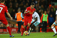 Roberto Firmino of Liverpool gets away from Michail Antonio of West Ham United. Premier League match, Liverpool v West Ham Utd at the Anfield stadium in Liverpool, Merseyside on Sunday 11th December 2016.<br /> pic by Chris Stading, Andrew Orchard sports photography.