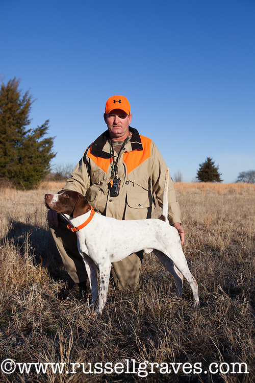 QUAIL HUNTER INTERACTING WITH HIS ENGLISH POINTER