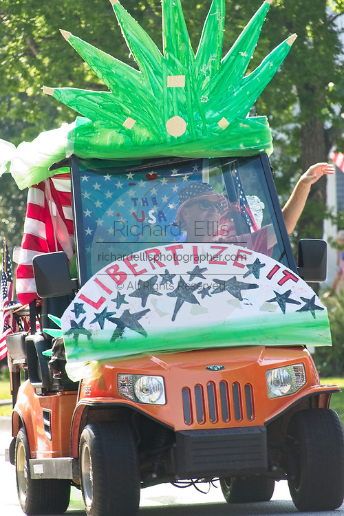 A man rides a pro-marijuana decorated golf cart during the annual Sullivan's Island Independence Day parade July 4, 2017 in Sullivan's Island, South Carolina. The tiny affluent sea island hosts a bicycle and golf cart parade through the historic village.