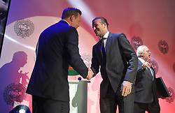 David Beckham makes his way to the stage to collect the PFA Merit Award from Chairman of the PFA Ritchie Humphreys during the Professional Footballers' Association Awards 2017 at the Grosvenor House Hotel, London