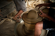 Making traditional pottery in Vigan.<br /> Ilocos Sur and Ilocos Norte are the Filipino provinces situated on Luzon Island and famous for heritage town of Vigan, windmills of Bangui, white sand beach of Pagudpud not to mention former president Marcos, who was born there.