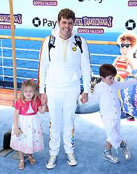 "Perez Hilton with his daughter Mia Alma Lavandeira and his son Mario Armando Lavandeira III at the premiere of ""Hotel Transylvania 3: Summer Vacation"" held at the Westwood Village Theatre in Los Angeles"