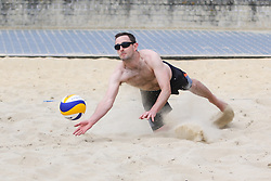 © Licensed to London News Pictures. 25/05/2015. Brighton, UK. A group of friends play Beach Volleyball on Brighton Beach. Thousands of people take to the beach in Brighton on the May Bank Holiday Monday, today May 25th 2015. Photo credit : Hugo Michiels/LNP