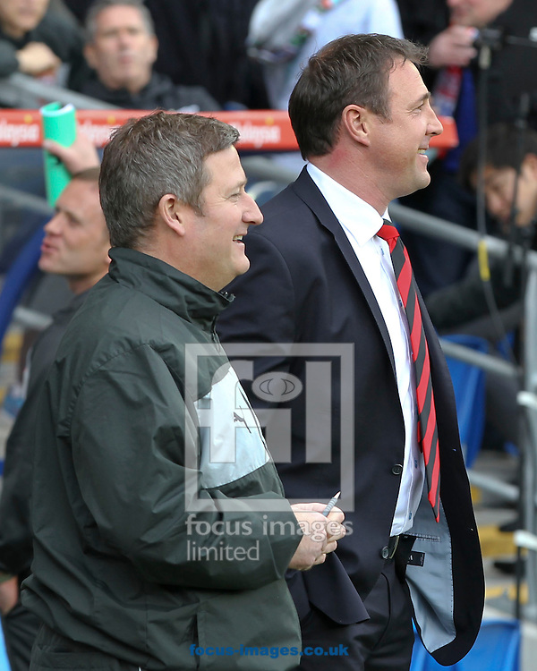 Picture by Mike  Griffiths/Focus Images Ltd +44 7766 223933.27/04/2013.Malky Mackay (R) and Assistant David Kerslake (L) of Cardiff City against Bolton Wanderers during the npower Championship match at the Cardiff City Stadium, Cardiff.