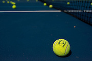 Tennis balls on the court at the Samuell Grand Tennis Center in Dallas, Texas on August 19, 2014. (Cooper Neill for The New York Times)