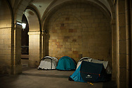Some tents placed under the arches of the city council to host some african migrants. Irun (Basque Country). October 15, 2018. A group of volunteers has created a host network to serve migrants and inform about the public services they are entitled to and the ways to cross the border. This group of volunteers is avoiding a serious humanitarian problem Irun, the Basque municipality on the border with Hendaye. As the number of migrants arriving on the coasts of southern Spain incresead, more and more migrants are heading north to the border city of Irun. French authorities have reacted by conducting random checks as far as the city of Bordeaux, more than 200 kilometers north of the border. Migrants who are caught are then deported back to Irun. (Gari Garaialde / Bostok Photo).